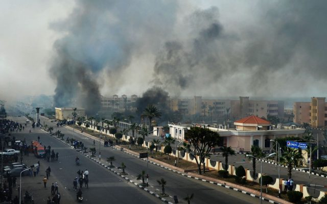 Smoke rises after Egyptian protesters clash with police in Port Said, Egypt, Sunday (photo credit: AP)
