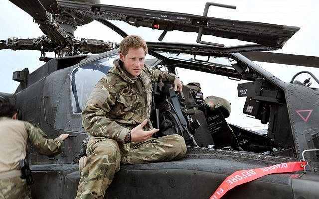 Britain's Prince Harry talks to a TV crew on Dec. 12, 2012 after making his early morning pre-flight checks on his Apache helicopter, from Camp Bastion, southern Afghanistan. (photo credit: John Stillwell/AP)