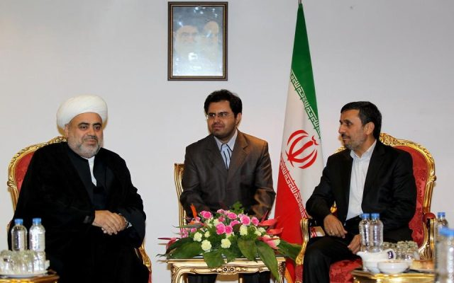 Hashemi translates at a meeting between Iranian President Mahmoud Ahmadinejad and a cleric from Azerbaijan (photo credit: Iranian presidential website)