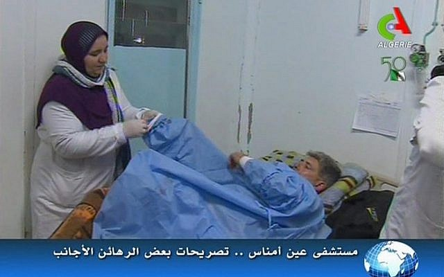 An unidentified rescued hostage receives treatment in a hospital in Ain Amenas, Algeria. (AP Photo/Canal Algerie via Associated Press TV)