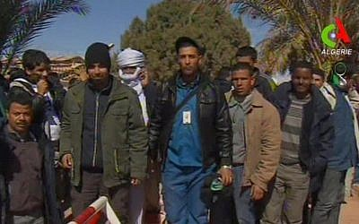 Unidentified rescued hostages pose for media in Ain Amenas, Algeria, in this image taken from television, January 2013 (photo credit: AP/Canal Algerie via Associated Press TV)