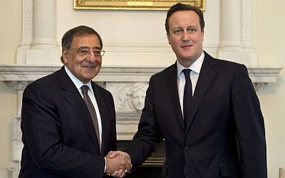 US Defense Secretary Leon Panetta, left, and British Prime Minister David Cameron shake hands before their meeting at 10 Downing Street in London on Friday. (AP Photo/Jacquelyn Martin)