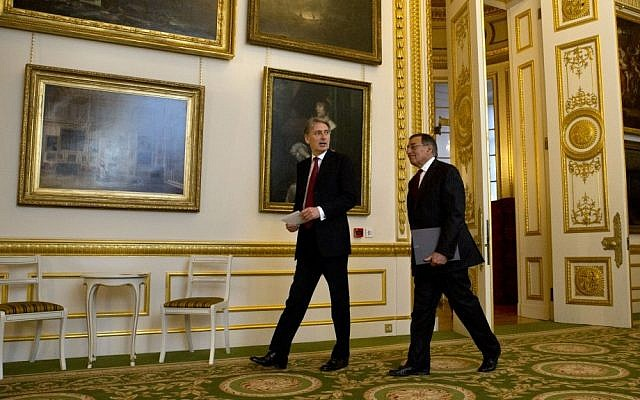 US Defense Secretary Leon Panetta (right) and Britain's Secretary of State for Defense Philip Hammond arrive at a news conference at Lancaster House in London on Satutrday. (photo credit: AP Photo/Jacquelyn Martin)