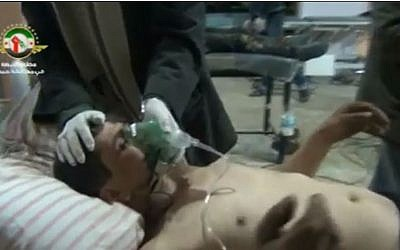 Alleged victim of chemical weapons attack on Homs, December 23rd 2012. (screen capture: Youtube/xmanw2011)