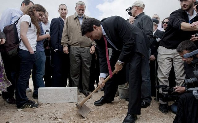 """Danon lays a symbolic cornerstone for new Jewish construction in east Jerusalem, November, 2009. Settlements, Danon says, """"are not an obstacle to peace"""" (Flash90)"""