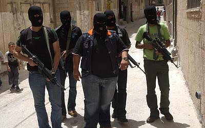 Masked members of Fatah's military branch patrol the streets in 2007. (photo credit: Wagdi Ashtiyeh/Flash90)