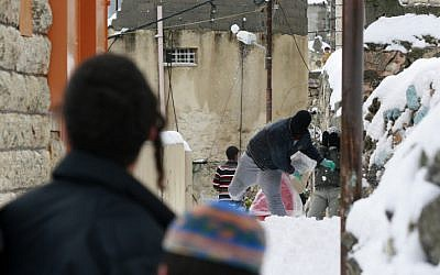 Israeli and Palestinian teenagers have a snowball fight in Hebron in 2008 (photo credit: Olivier Fitoussi/Flash90)