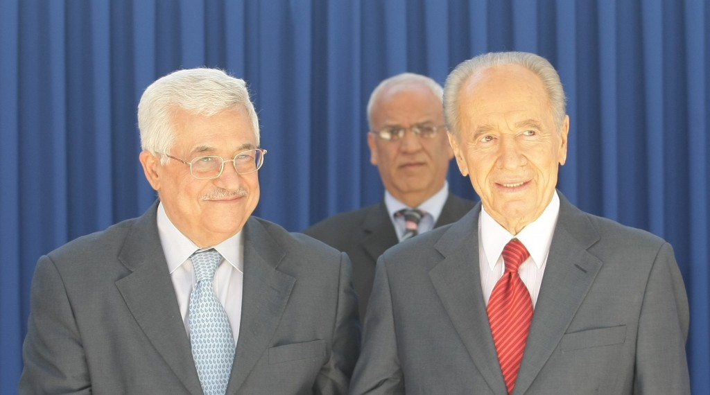 President Shimon Peres with Palestinian Authority President Mahmoud Abbas in 2008. Standing behind them is PA negotiator Saeb Erekat. (photo credit: Kobi Gideon/Flash90)