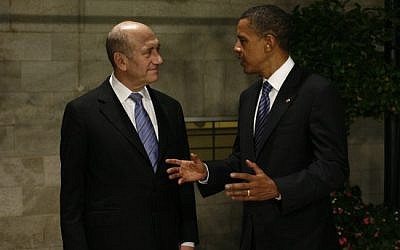 Ehud Olmert (left) and Barak Obama (right) in Jerusalem, 2008 (photo credit: Olivier Fitoussi/Flash90)