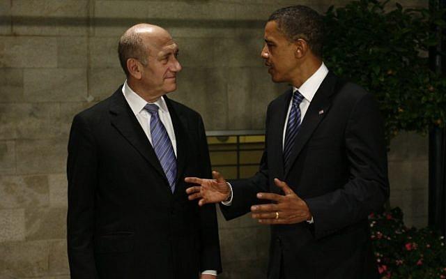 Ehud Olmert (left) and Barak Obama (right) in Jerusalem, 2008 (photo credit: Olivier Fitoussi/Flash90)