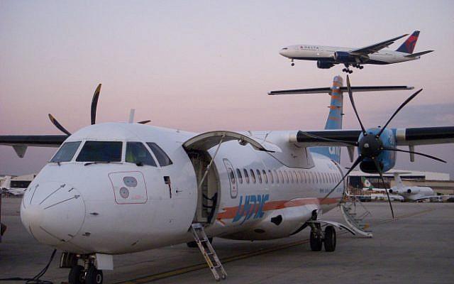 An illustrative photo of a plane landing at Ben Gurion Airport. (photo credit: Tsahi Ben-Ami / Flash 90)