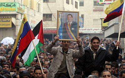 Venezuelan flags and portraits of Hugo Chavez feature prominently at a demonstration in Ramallah against Operation Cast Lead, Jan 9, 2009 (photo credit: Issam Rimawi/Flash 90)