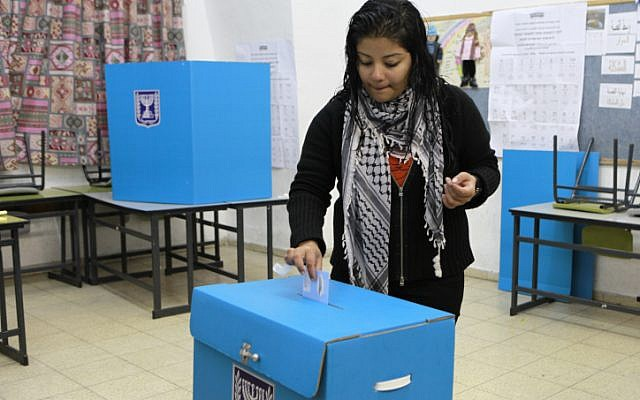 An Arab Israeli woman casts her vote at a polling station in the Arab village of Abu Ghosh in 2009. (photo credit: Nati Shohat/Flash90)