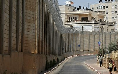Illustrative photo of a section of the security barrier in Jerusalem's Beit Hanina neighborhood in 2009. (photo credit: Kobi Gideon/Flash90)
