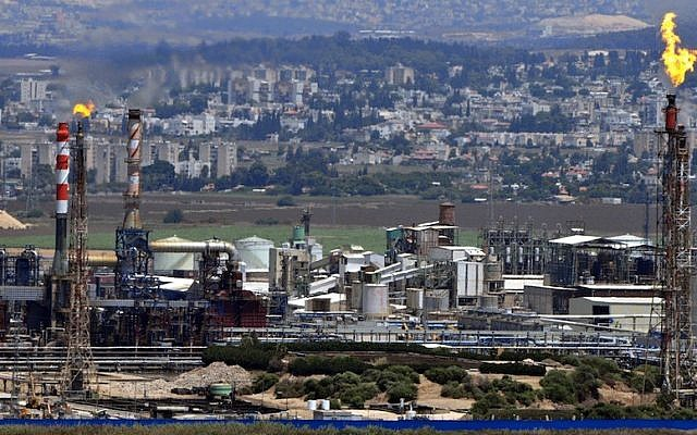 View of chimneys from a refinery in Haifa Bay (Photo credit: Shay Levy/Flash90)