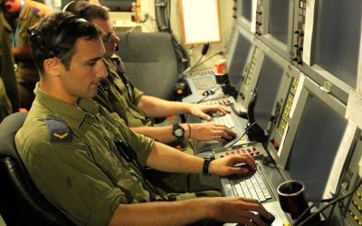 IDF soldiers at a control board in the National Cyber Bureau (Photo credit: Moshe Shai/FLASH90)