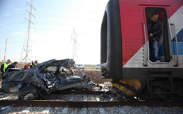 A train collided with a car near kibbutz Gat on December 27, 2009 (photo credit: Dov Biladi/ZAKA Spokesperson/Flash90)
