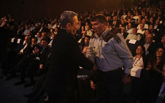 Lt. Gen. (res) Gabi Ashkenazi shaking Barak's hand with visible discomfort on his last day in uniform (Photo credit: Michael Shvadron: IDF Spokesperson's Office/ Flash 90)