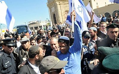 Itamar Ben Gvir, in blue, and Baruch Marzel, with beard, marching through Jaffa in 2011. (photo credit: Yossi Zeliger/Flash90)