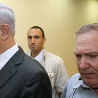 Prime Minister Benjamin Netanyahu with his then-aide Natan Eshel, on August 28, 2011. (Amit Shabi/pool/Flash90/File)