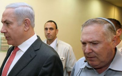 Prime Minister Benjamin Netanyahu (left) with his then-aide Natan Eshel, on August 28, 2011. (Amit Shabi/pool/Flash90/File)