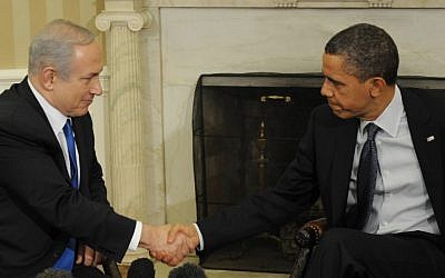 Benjamin Netanyahu, left, and Barack Obama shaking hands at a meeting in the White House in March 2012 (photo credit:  Amos Ben Gershom/GPO/Flash90)