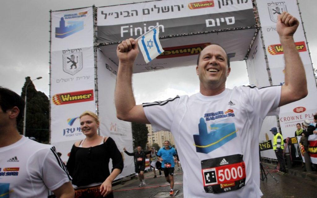 Mayor of a 'normal' city: Nir Barkat finishes the half-marathon, during the International Jerusalem Marathon in March 2013. (photo credit: Miriam Alster/Flash90)