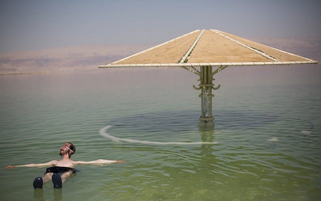 The shrinking Dead Sea received a much needed boost of ten centimeters to water levels following last week's storm (photo credit: Yonatan Sindel/Flash90)