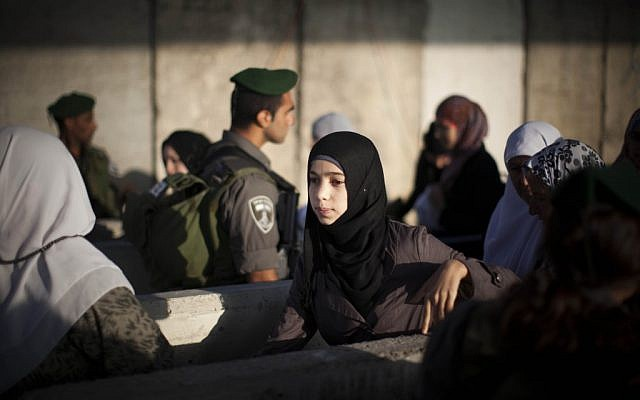 Israeli Border Police officers check documents of Palestinian women at the Qalandia checkpoint on the outskirts of the West Bank city of Ramallah (illustrative photo: Yonatan Sindel/Flash90)