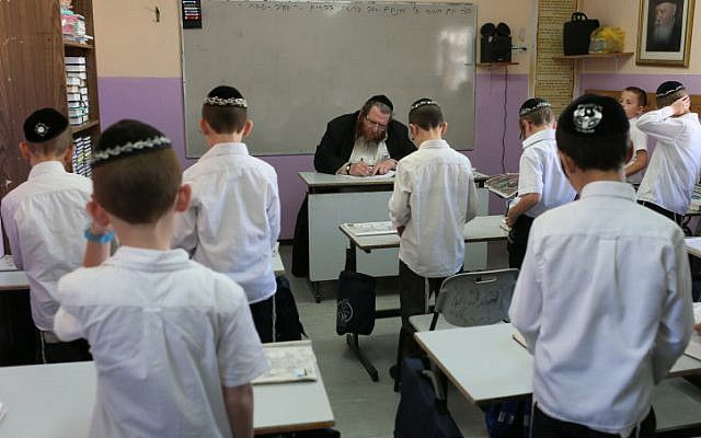 Illustrative photo: Young ultra-Orthodox students pray in their classroom (photo credit: Nati Shohat/Flash90)