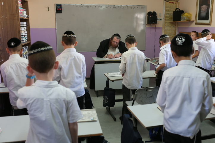 Young ultra-Orthodox students pray in their classroom (photo credit: Nati Shohat/Flash90)