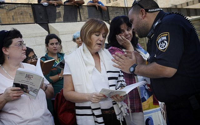 Police arresting Women of the Wall head Leslie Sachs in October 2012 for praying at the Western Wall with a tallit. (photo credit: Miriam Alster/Flash90)