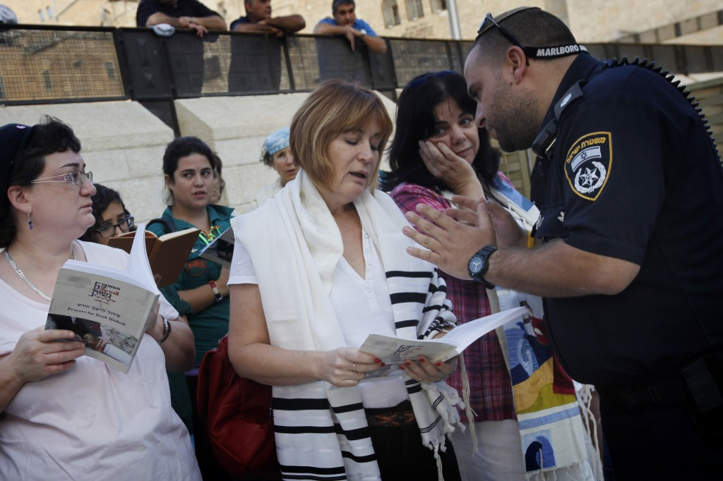 Lesley Sachs, director of 'Women of the Wall,' is confronted by police for wearing a 'tallit' (prayer shawl) at the Western Wall last October (Photo credit: Miriam Alster/FLASH90)