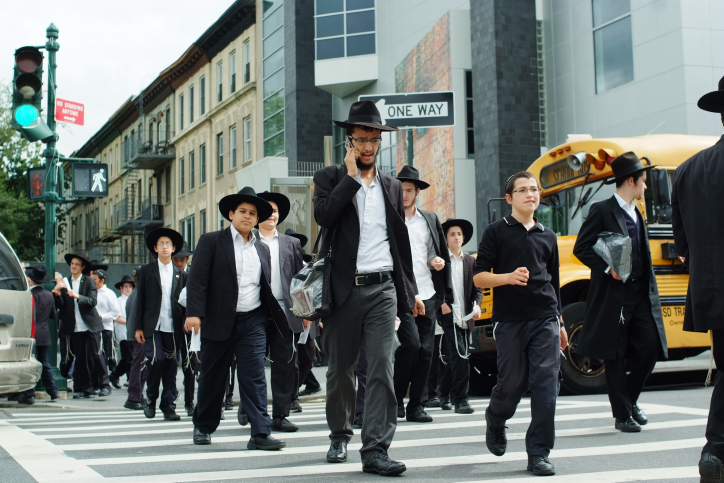 Ultra-Orthodox Jews cross the street in Brooklyn (photo credit: Mendy Hechtman/Flash90)
