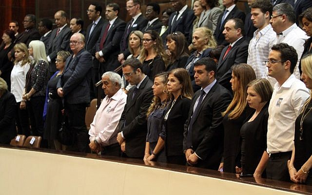 Knesset members stand during a ceremony marking 17 years since the assassination of Yitzhak Rabin, on October 28, 2012. (photo credit: Yoav Ari Dudkevitch/Flash90)
