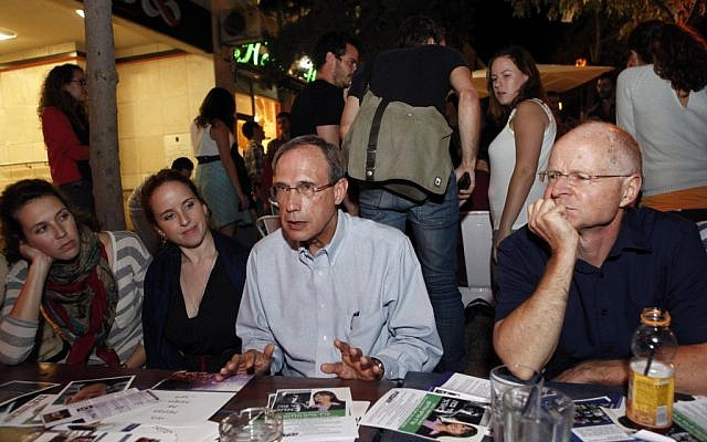 Labor MK Nachman Shai (center) is flanked by fellow party members Stav Shaffir (left), and Noam Shalit (right) as they address young voters at a Jerusalem pub on November 7,2012. (photo credit: Yonatan Sindel/Flash90).