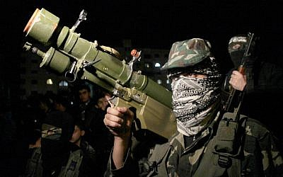 Gunmen from the Ezzedine al-Qassam Brigades, the armed wing of Hamas, in Gaza City on November 22, 2012 (photo credit: Abed Rahim Khatib/Flash90)