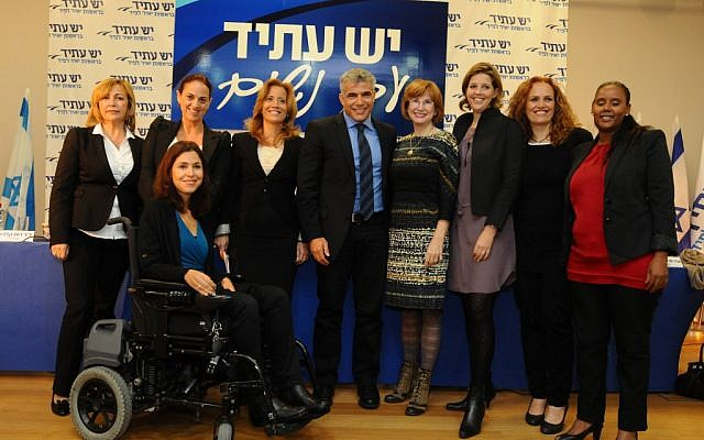 Yesh Atid Knesset candidates, from left, Rina Frenkel, Ruth Calderon, Karin Elharar (in chair), Aliza Lavie, Yair Lapid, Yael German, Adi Kol, Yifat Kariv and Penina Tamnu-Shata. (photo credit: Yossi Zeliger/Flash90