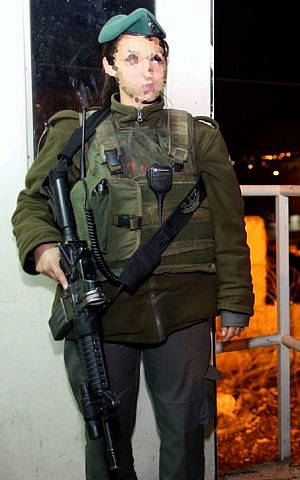 An Israeli border police officer after she shot and killed an armed man in Hebron, December 12, 2012. (photo credit: Oren Nachshon/Flash90)