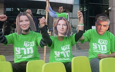 Meretz supporters wear masks depicting Shelly Yachimovich, Tzipi Livni and Yair Lapid, protesting their alleged willingness to join a Netanyahu government, December 17, 2012. (photo credit: Roni Schutzer/Flash90)