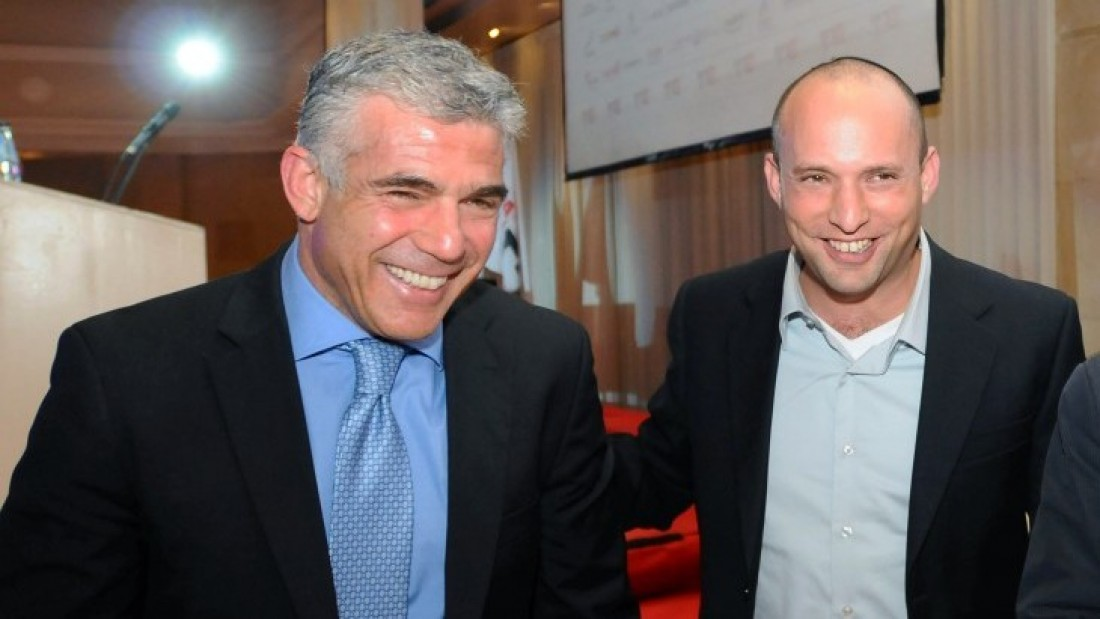 Yesh Atid leader Yair Lapid (left) and Jewish Home leader Naftali Bennett at a conference in Ramat Gan, December 17, 2012. (Photo credit: Yossi Zeliger/Flash90)