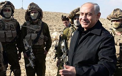 Prime Minister Benjamin Netanyahu attends on Wednesday the ceremony marking the completion of the main section of the Israeli-Egyptian border fence (photo credit: Moshe Milner/GPO/FLASH90)