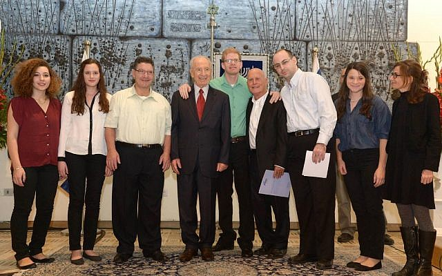 President Shimon Peres with chairman Ami Ayalon and young artists and students from AKIM (photo credit: Mark Nayman/Flash90)