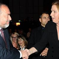 Avigdor Liberman and Tzipi Livni shaking hands in January 2013. (photo credit: Flash90)