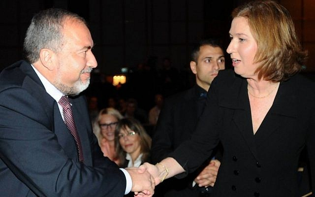 Avigdor Liberman (left) and Tzipi Livni shaking hands in January 2013. (Flash90)