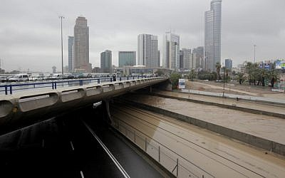 The Ayalon River flows alongside the flooded Ayalon Highway in Tel Aviv on Tuesday, Jan. 8 (photo credit: Flash90)