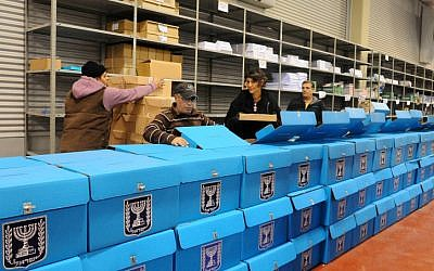 Workers prepare ballot boxes for the upcoming Israeli election at a warehouse near Tel Aviv before they are shipped to polling stations, January 2013. (photo credit: Yossi Zeliger/Flash90)
