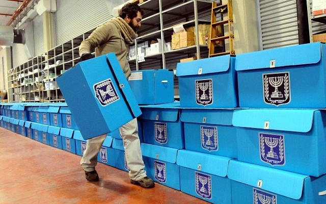 A worker on Tuesday prepares ballot boxes for the January 22 elections at a warehouse in Shoham, near Tel Aviv, before they are shipped to polling stations. (photo credit: Yossi Zeliger/Flash90)