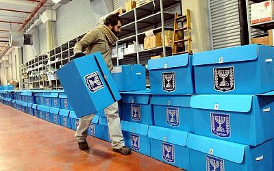 A worker prepares ballot boxes for the previous elections, at a warehouse in Shoham, near Tel Aviv, January 8, 2013 (photo credit: Yossi Zeliger/Flash90)