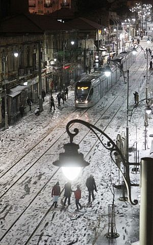Jerusalem's snowy light rail Wednesday night (photo credit: Miriam Alster/Flash90)